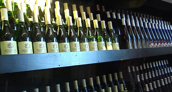 a row of bottles on a shelf